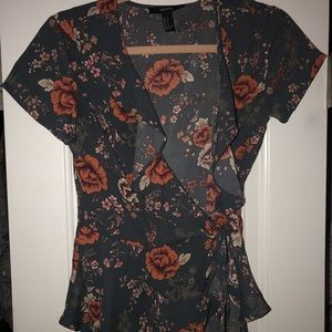 Wrap and tie flowered blouse